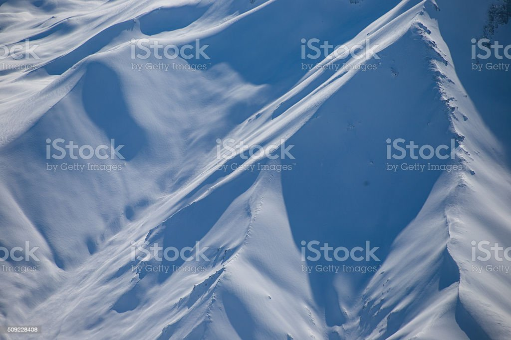 Pristine snow slopes of the Himalayas in India. stock photo