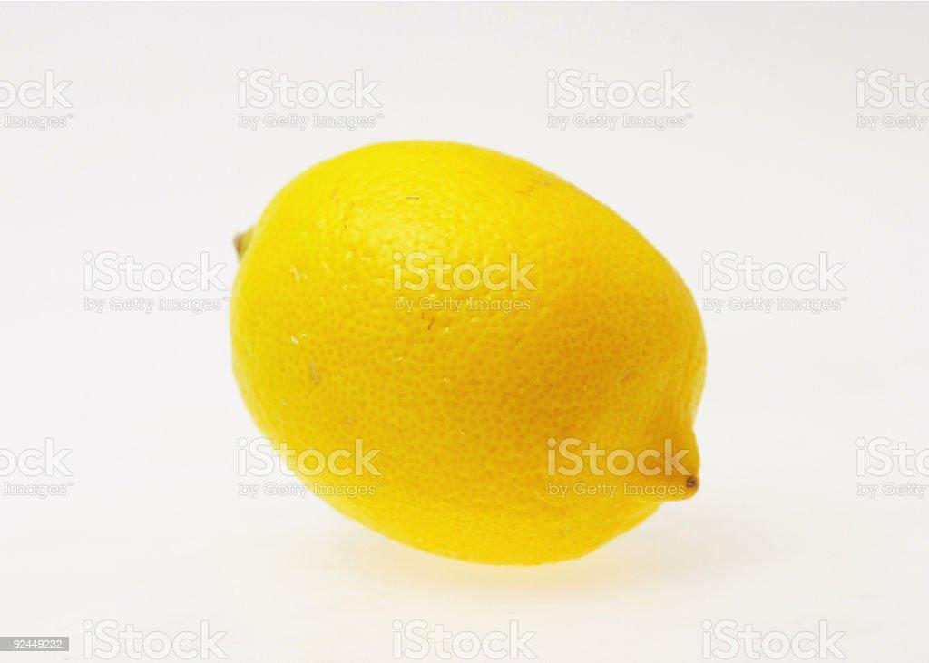 Pristine, yellow lemon on a white background royalty-free stock photo