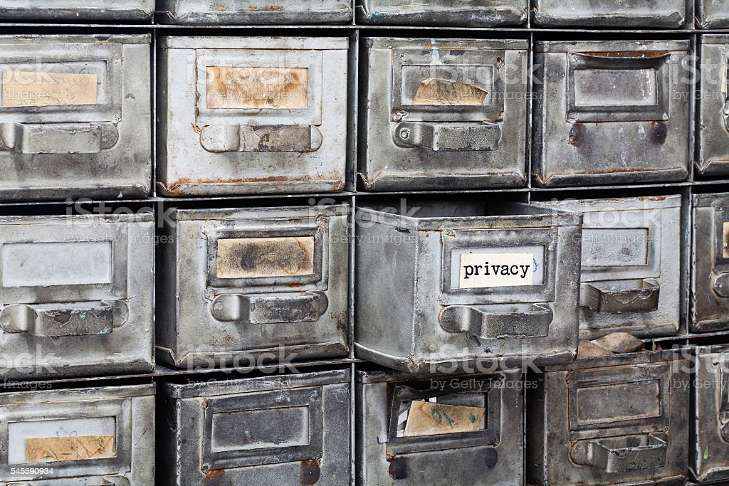Privacy information concept. filing system with opened metallic box. Aged stock photo