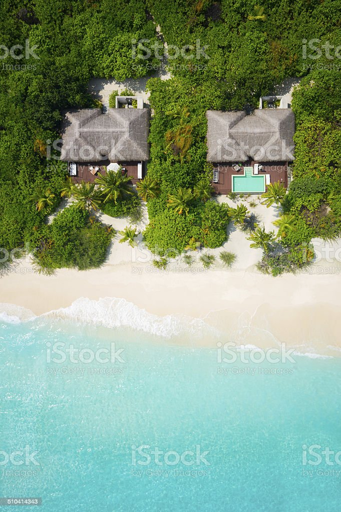 top view aerial private luxury villas with sandy beach and turquoise...