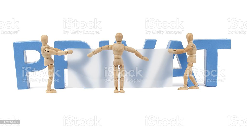 Privat - wooden mannequins tries to hide it royalty-free stock photo