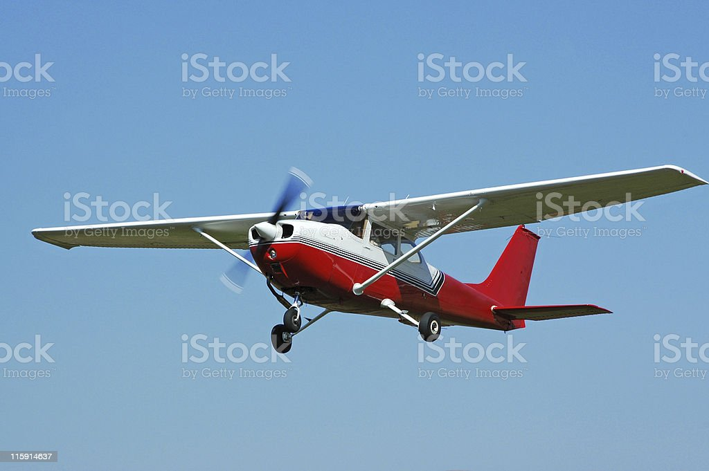 private airplane Cessna 172 flying in clear blue sky stock photo