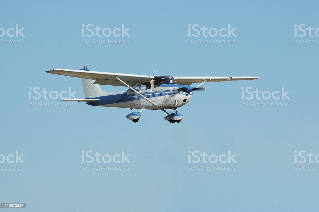 private airplane Cessna 172 in clear blue sky stock photo