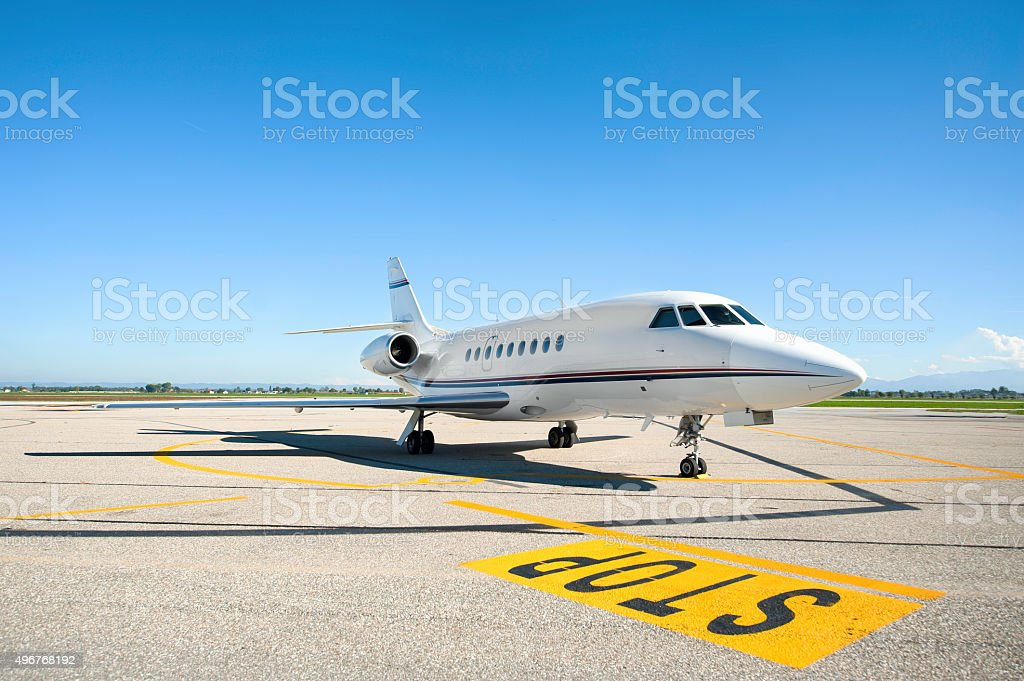 Private airplane on runway stock photo