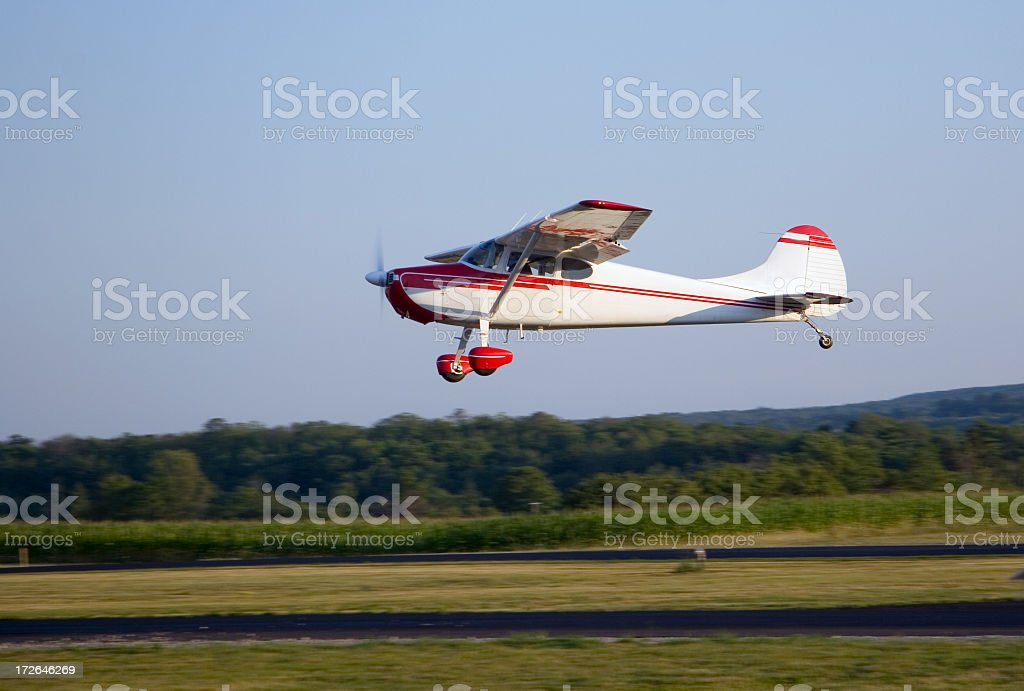 Private airplane taking off from runway stock photo