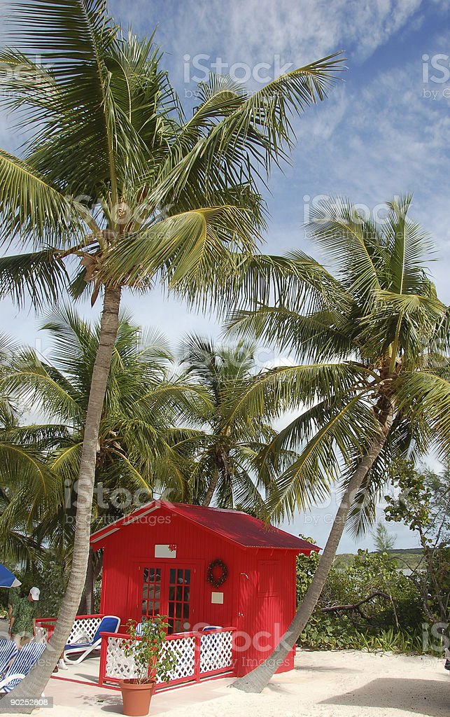 Private beach front bungalow in red color royalty-free stock photo