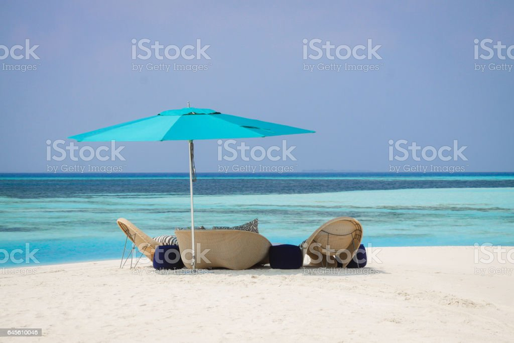 Private Beach sunbeds stock photo