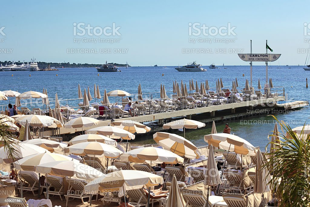 Private beachfront with parasols in Cannes, France stock photo