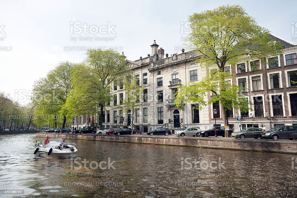 private boat in Golden bend of herengracht amsterdam stock photo