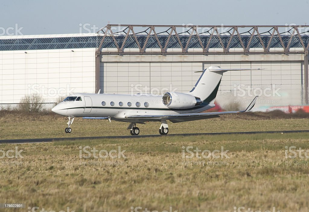 Private Business Jet Aircraft lifting off runway royalty-free stock photo