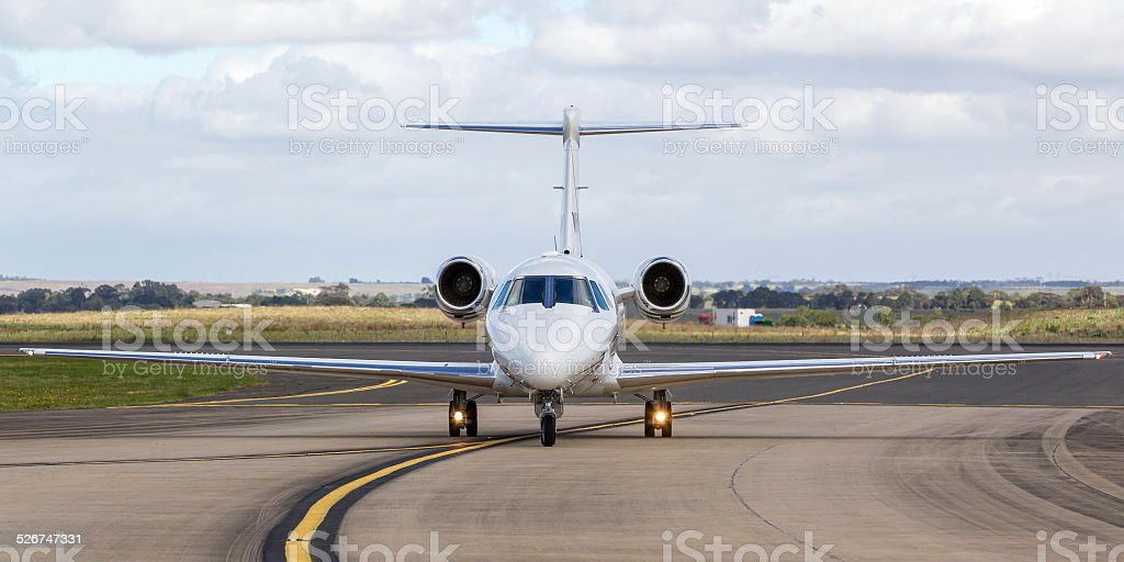 Private Business jet on a taxiway stock photo