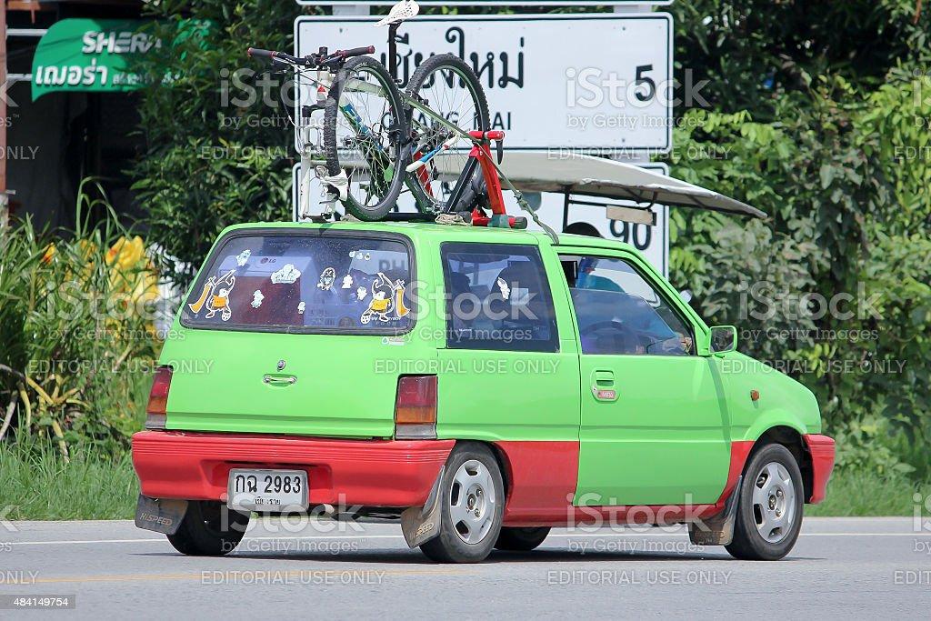 Private car with Bicycle, Daihatsu Mira stock photo