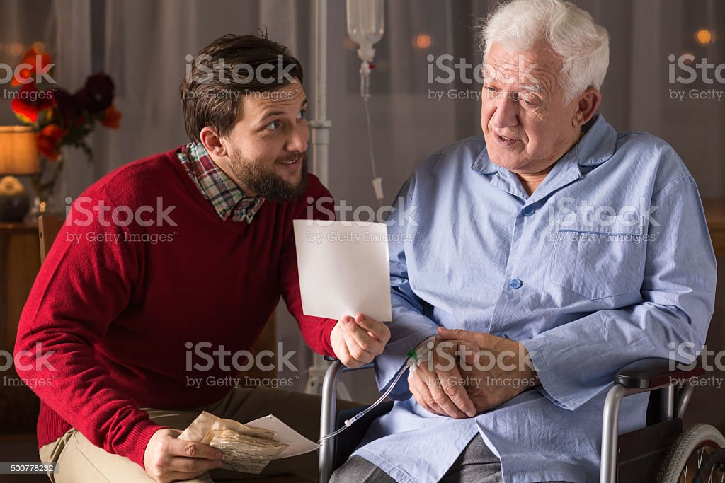Private carer and elderly man stock photo