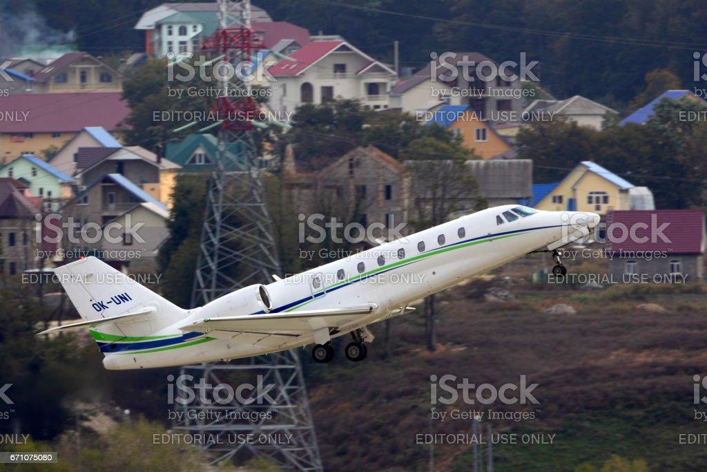 SOCHI, RUSSIA - OCTOBER 31, 2012: Private Cessna 680 Citation Sovereign taking off at Sochi-Adler international airport. stock photo