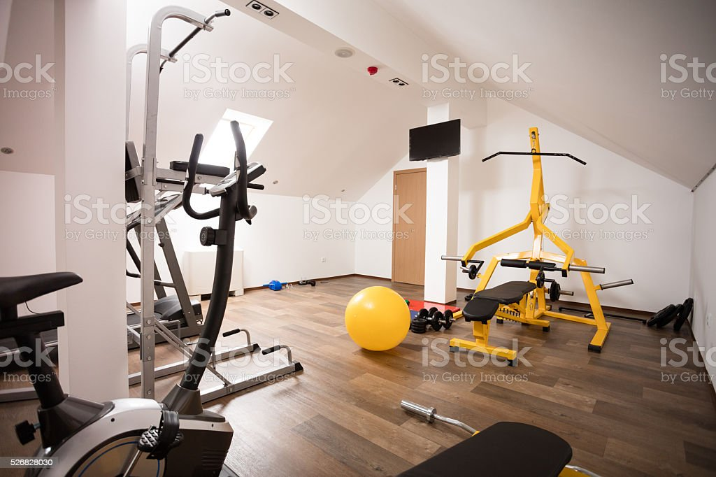 Private gym in the attic of modern house stock photo