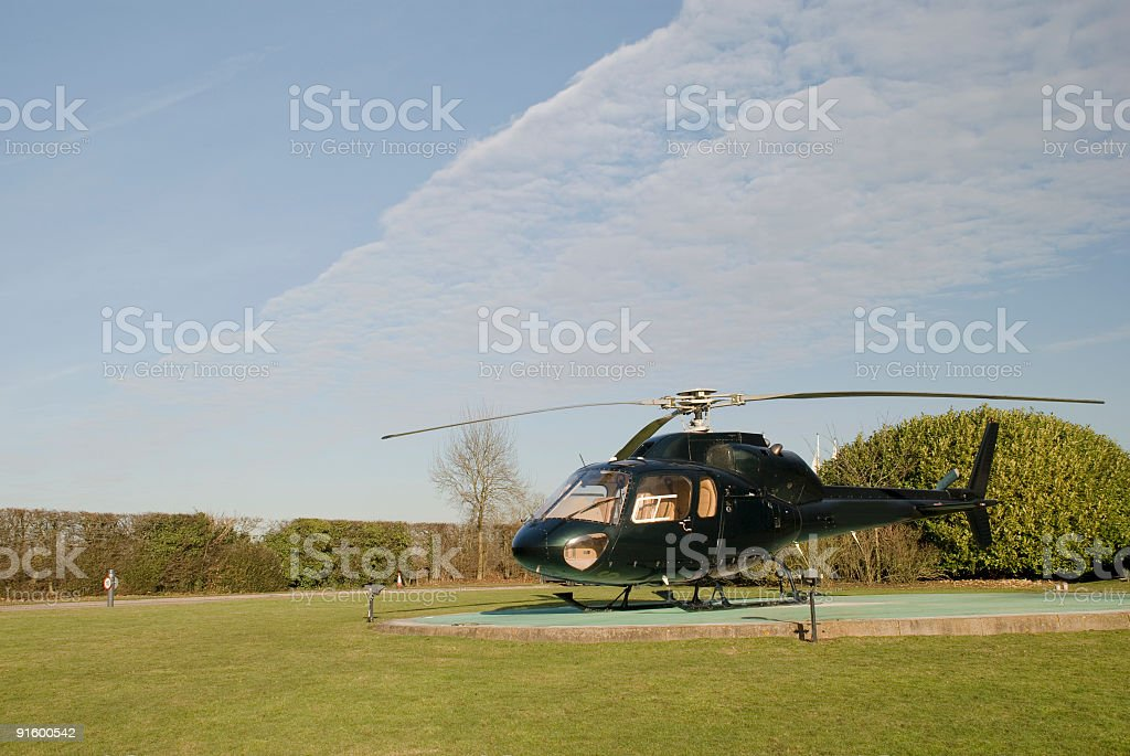 Private helicopter on helipad stock photo