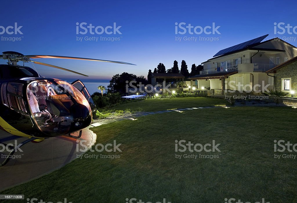 Private helicopter parked in front of mansion royalty-free stock photo