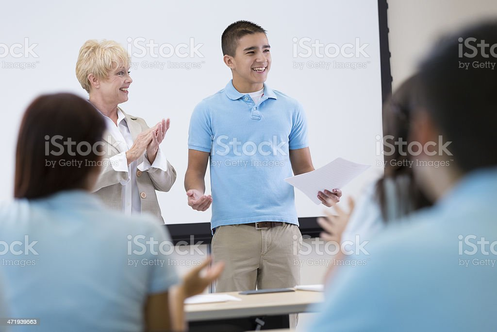 Private high school student giving speech in front of classroom stock photo