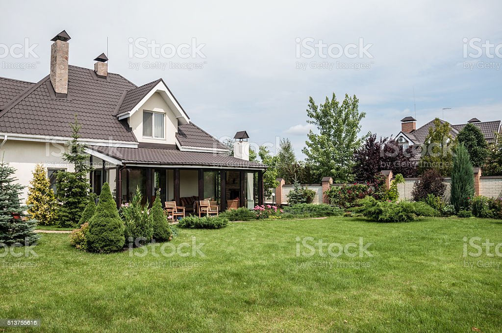 private house with a garden in rural area stock photo