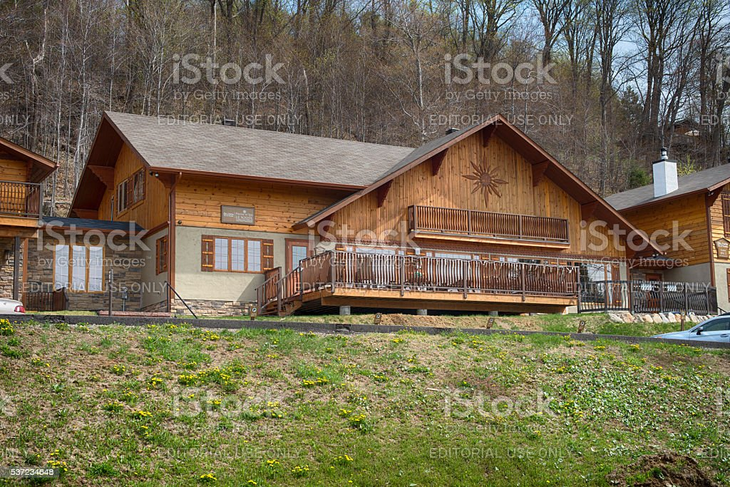private house with a garden in rural mountain area stock photo