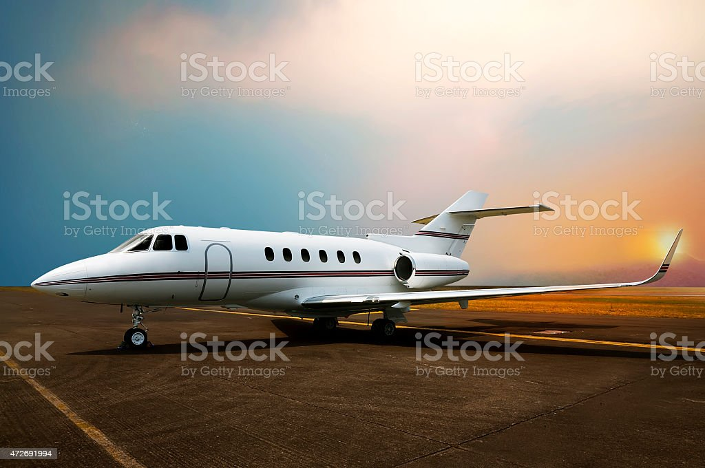 Private jet airplane parking at the airport. stock photo