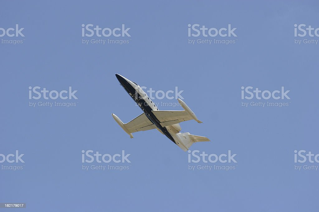 Private jet climbing into blue sky royalty-free stock photo