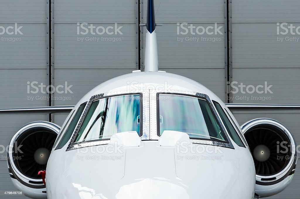 Private Jet in hangar stock photo
