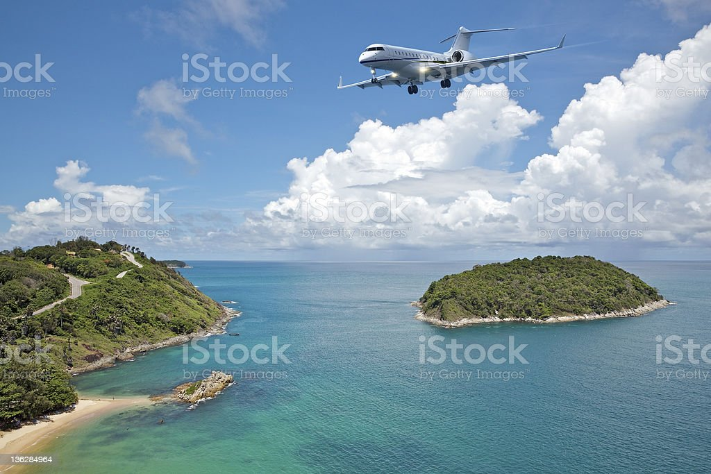 Private jet is going to the tropical island stock photo