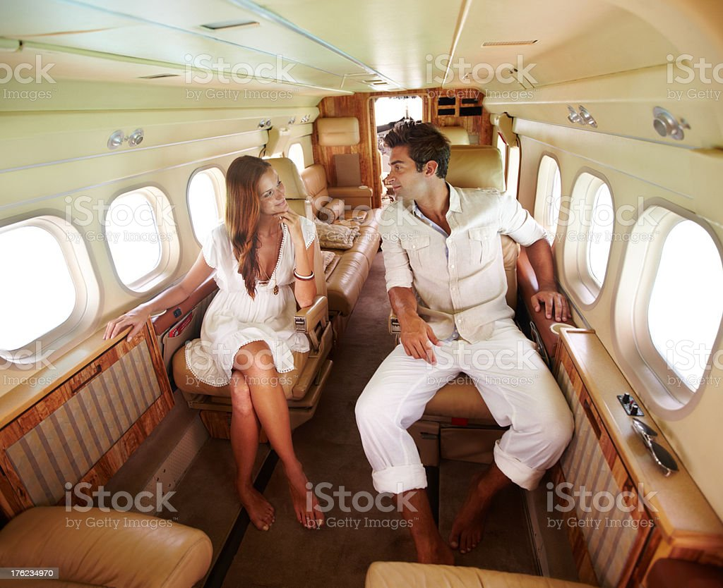 Private Jet Lifestyle - Young couple in love living the high life stock photo