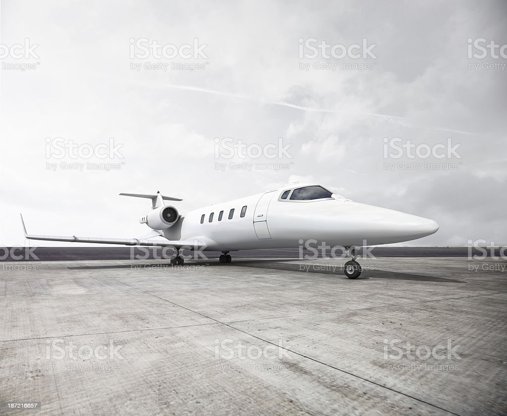 A private jet on the runway about to take off stock photo