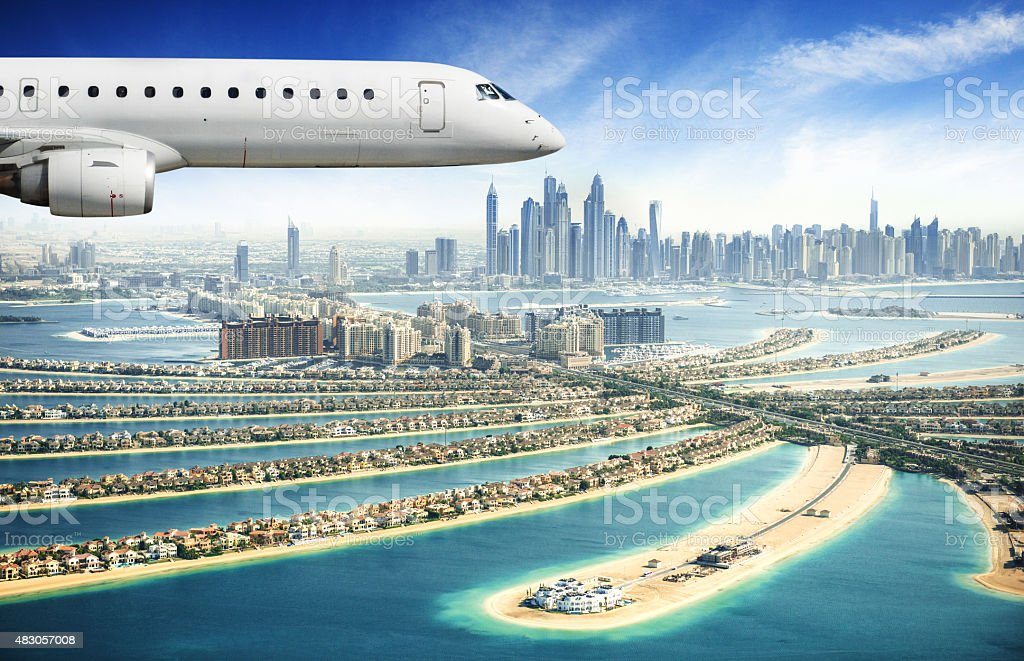 private jet over the palm jumeirah stock photo