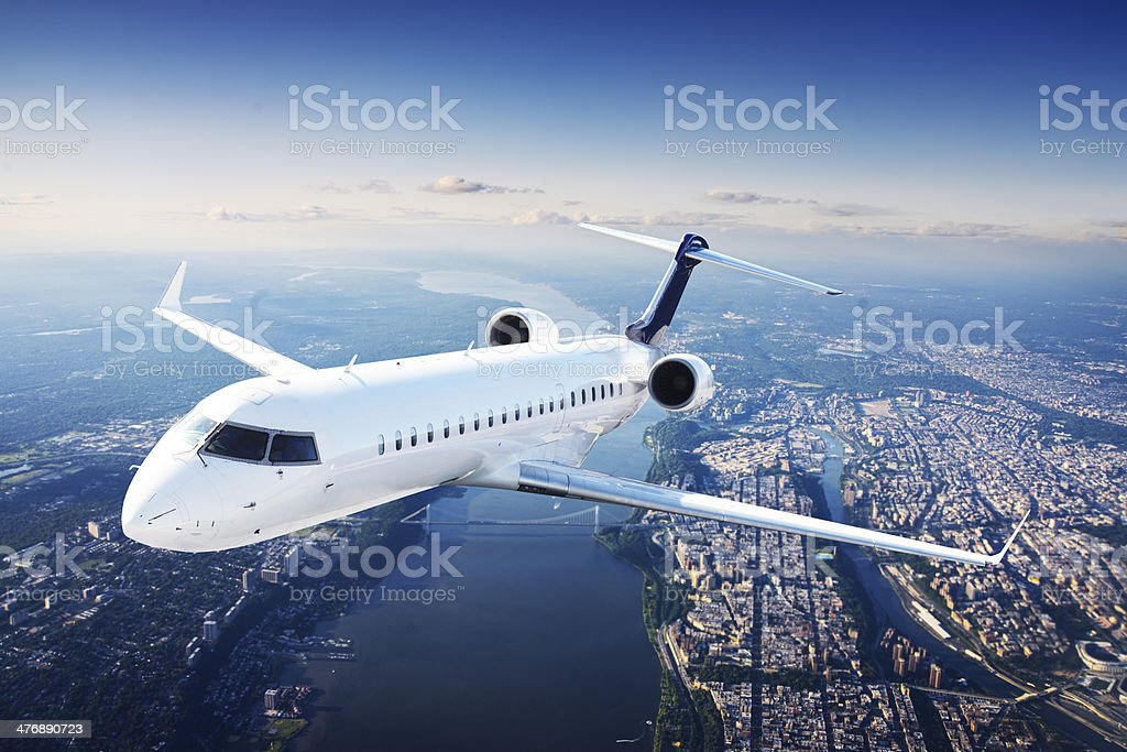 Private jet plane in the blue sky stock photo