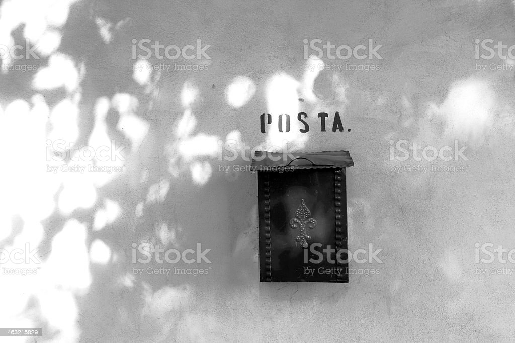 Private mailbox hanging in the shade of a tree stock photo