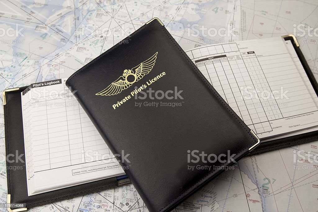 Private pilots license on logbook and chart royalty-free stock photo