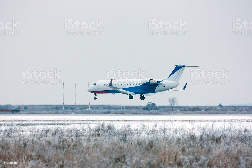 Private plane landing at the cold winter airport royalty-free stock photo