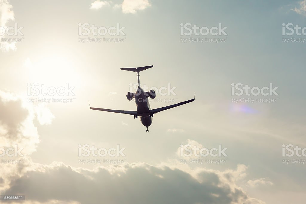 Private plane landing in backlight royalty-free stock photo