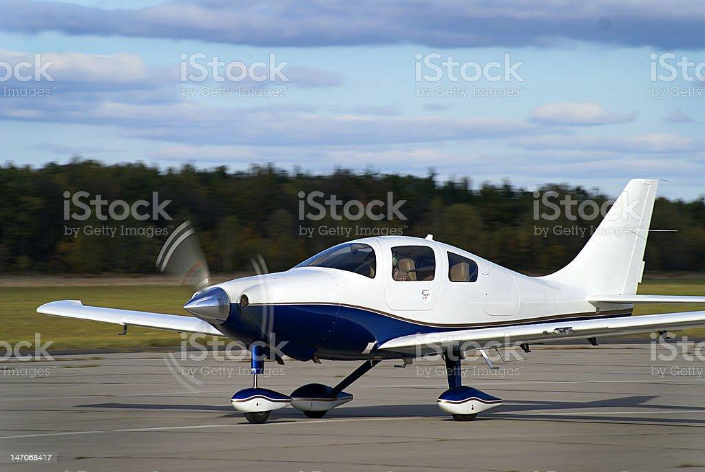 Private plane takeoff stock photo