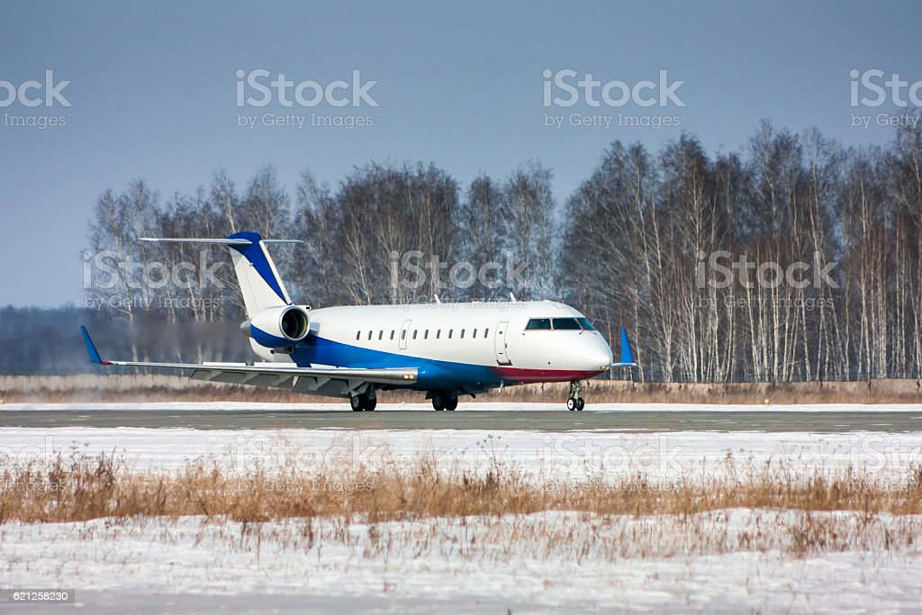 Private plane taxiing on the runway royalty-free stock photo