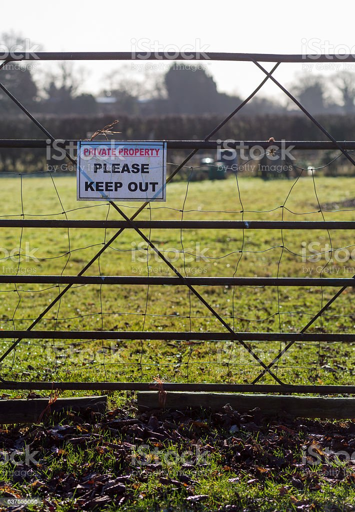 Private property please keep out printed sign on metal fence stock photo