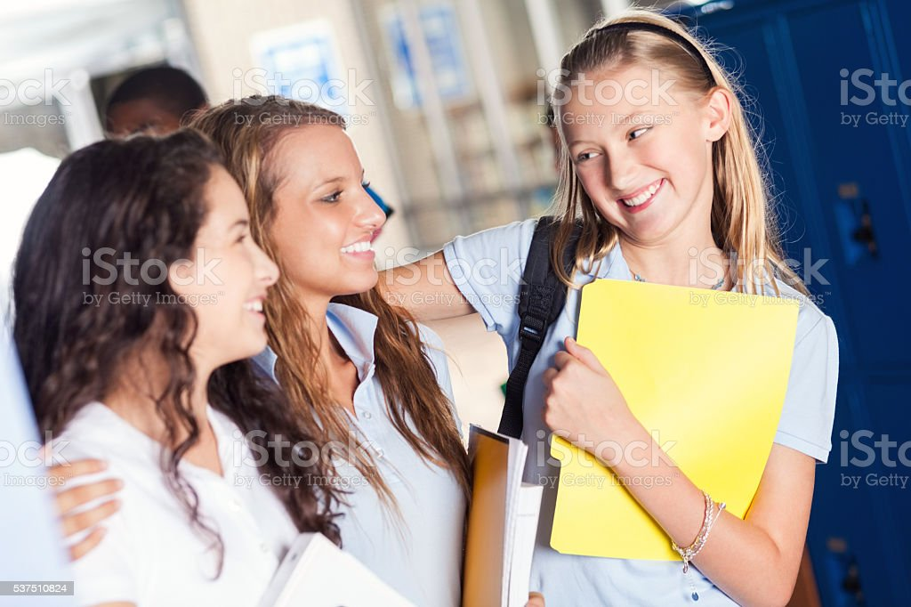 Private school girls have fun before class stock photo