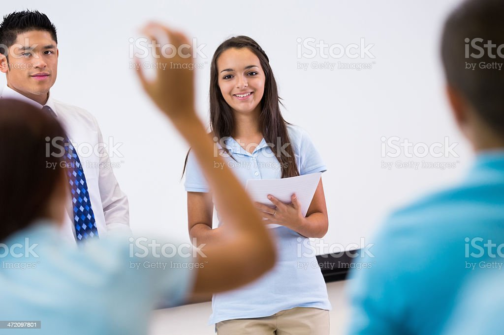 Private school student giving presentation in front of classmates stock photo
