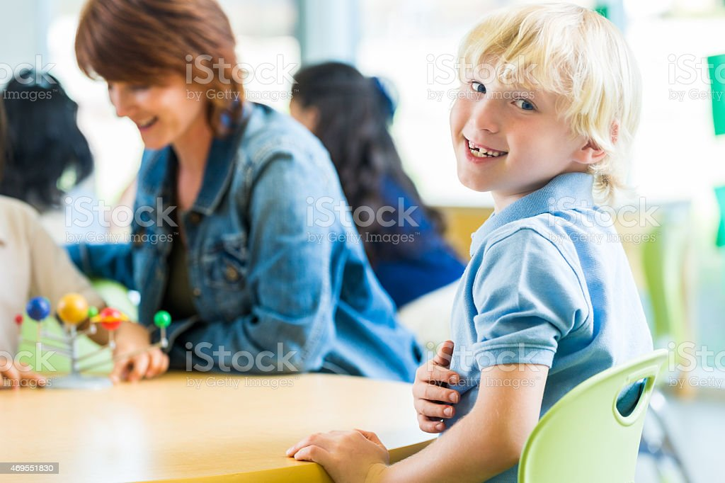 Private school student smiling in a classroom stock photo