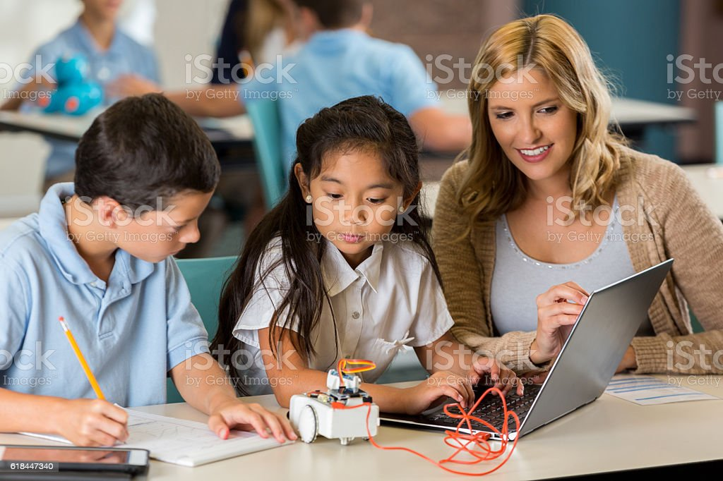 STEM private school students concentrate on robotics project stock photo
