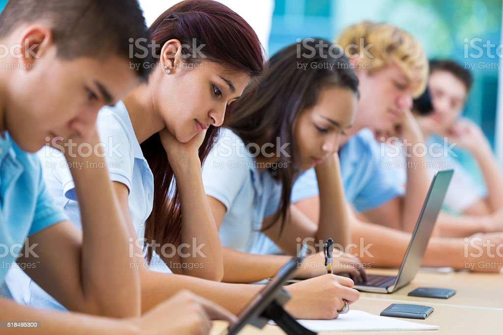 Private school students work in class stock photo
