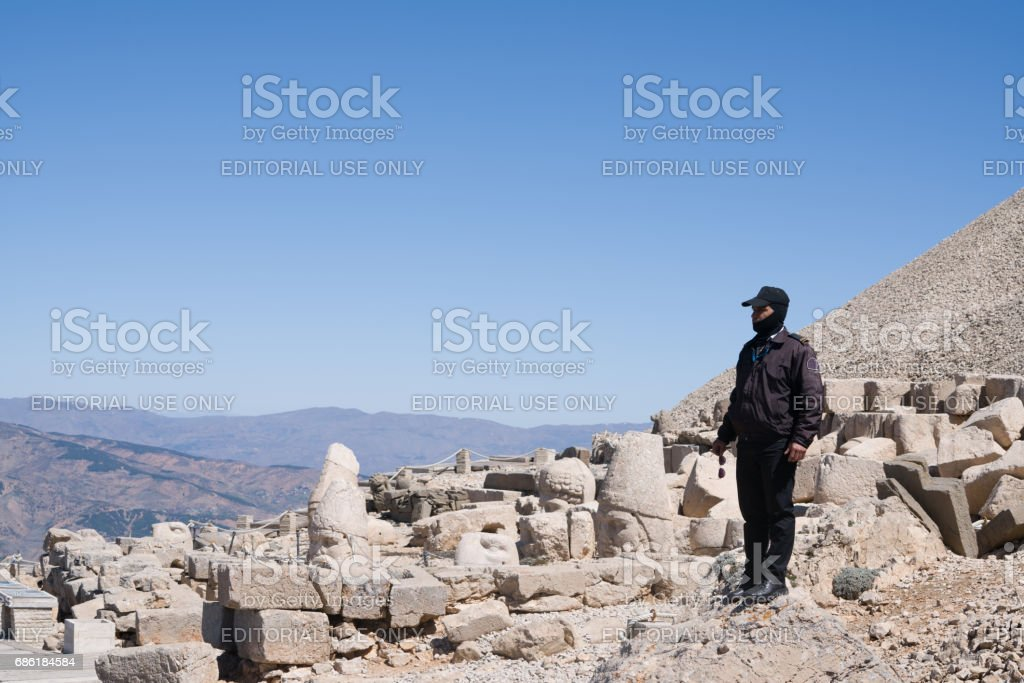 Private security guarding the statues on Nemrut mountain stock photo