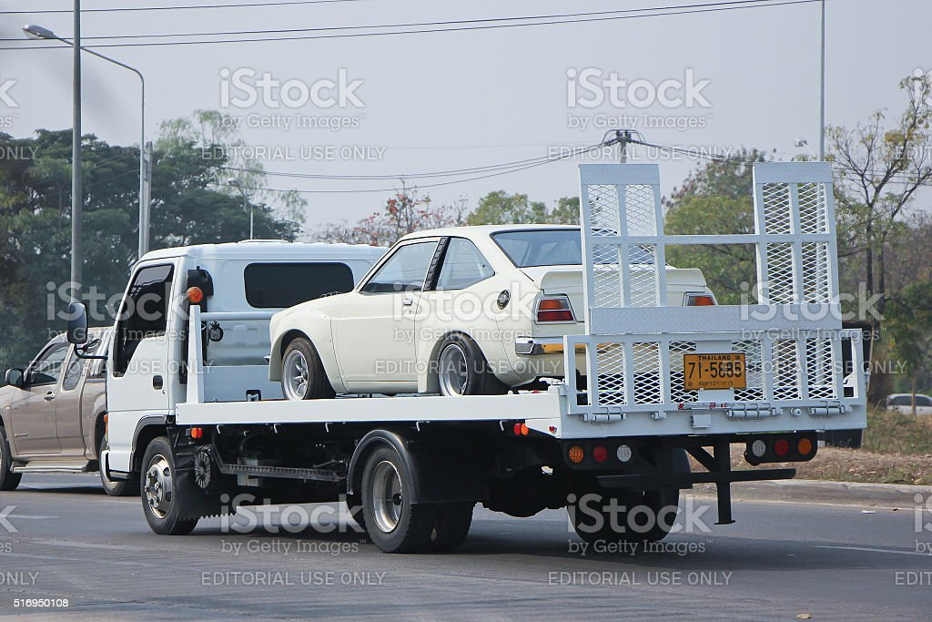 Private Slide up tow truck for emergency car move. stock photo