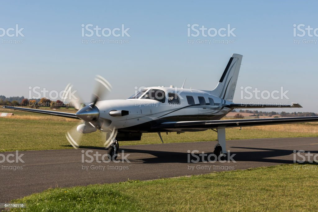 Private small single turboprop aircraft on airport runway stock photo