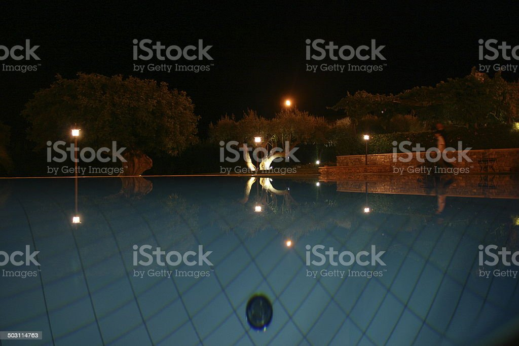 private swimming pool in the evening royalty-free stock photo
