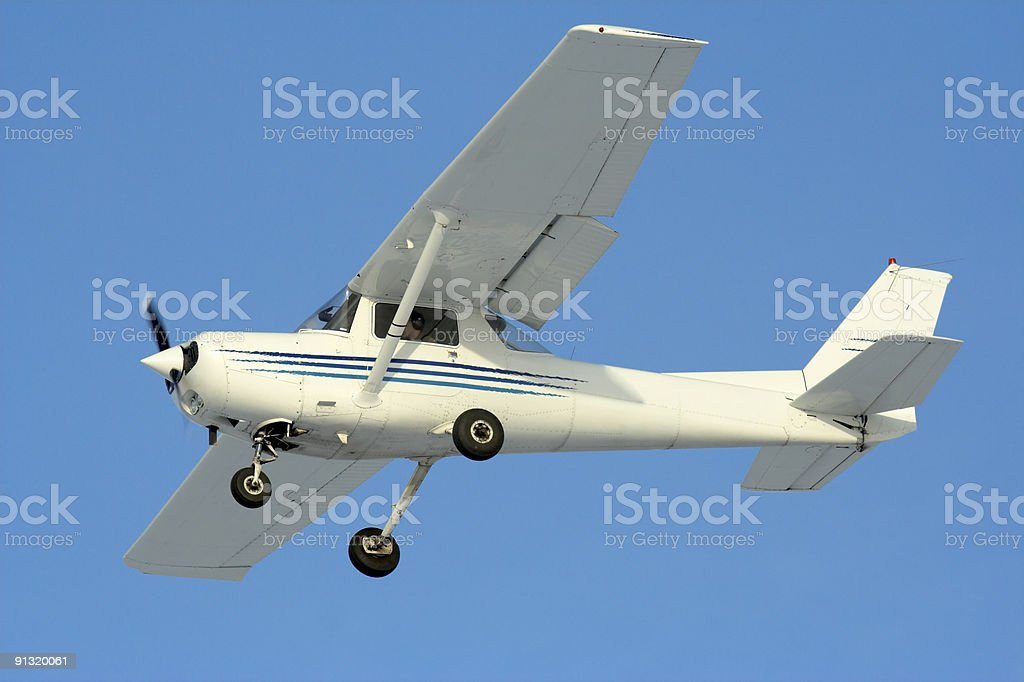 Private white airplane flying in the sky royalty-free stock photo