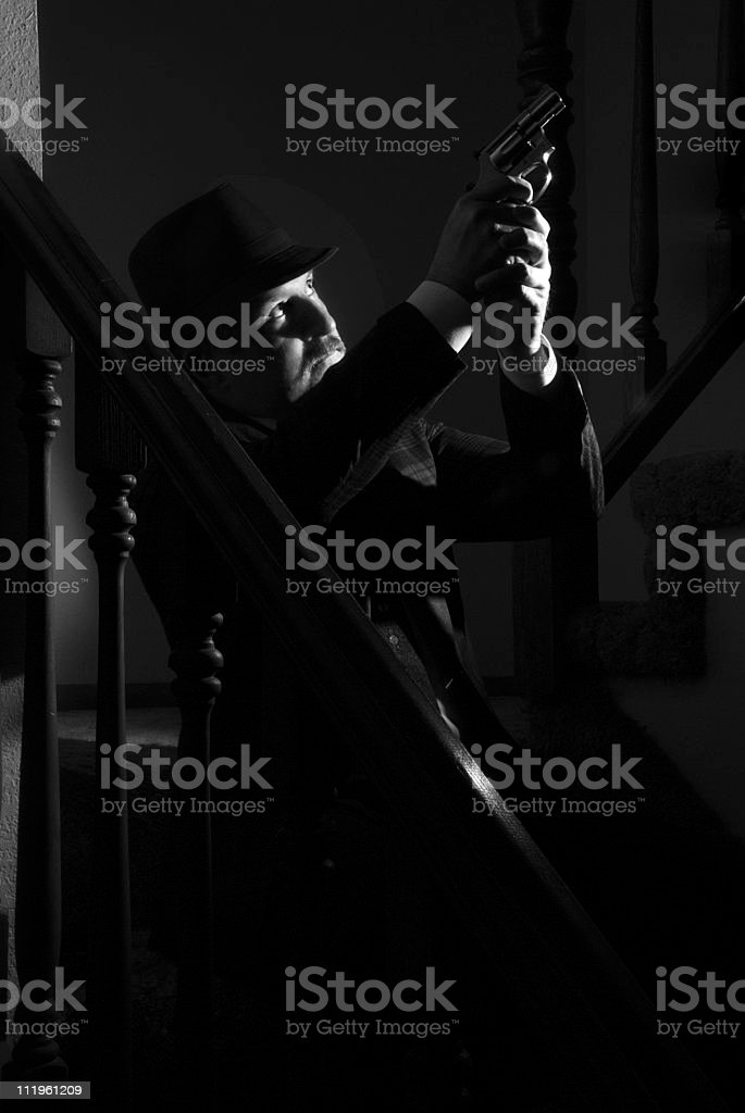 Priviate eye pointing a gun at someone film noir style stock photo